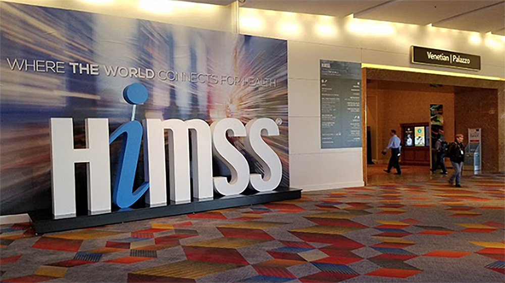 Large HIMSS logo in the hallway